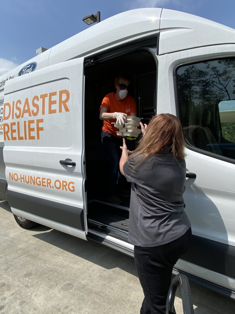 Second Harvest volunteers provide relief to New Orleans community members during the Coronavirus pandemic. Courtesy Second Harvest Food Bank